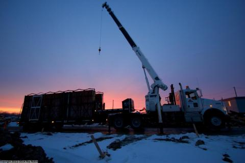 Unloading housing forms at the break of dawn on a 18 Ton