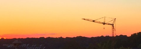 self-erecting-tower-crane-in-the-sunset